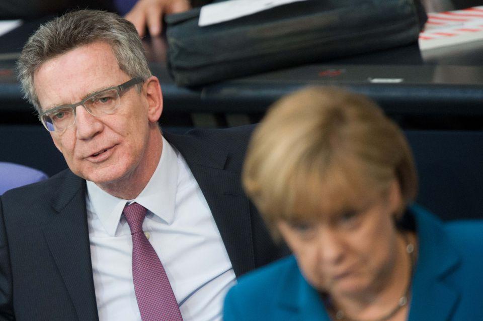 Thomas de Maizière und Angela Merkel