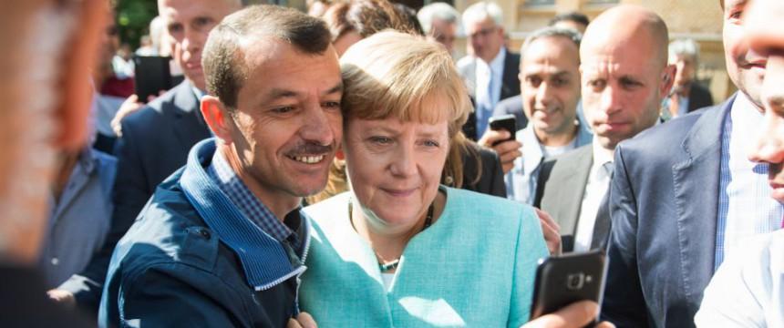 Bundeskanzlerin Angela Merkel (CDU) besucht eine Einrichtung für Asylbewerber  in Berlin Foto: picture alliance/dpa
