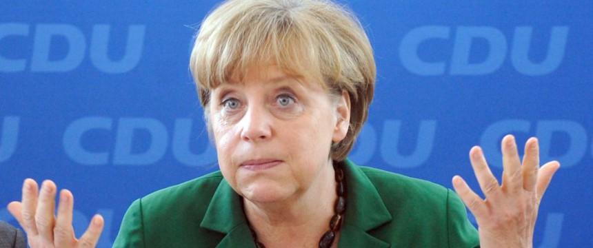 """Bundeskanzlerin Angela Merkel (2012) (Foto: picture alliance/dpa), Veröffentlichung mit freundl. Genehmigung der Wochenzeitung """"Junge Freiheit"""""""