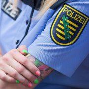 Sächsisches Landeswappen auf Polizeiuniform Foto: picture alliance/dpa