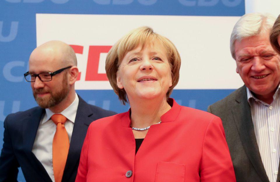 Peter Tauber, Angela Merkel und Volker Bouffier