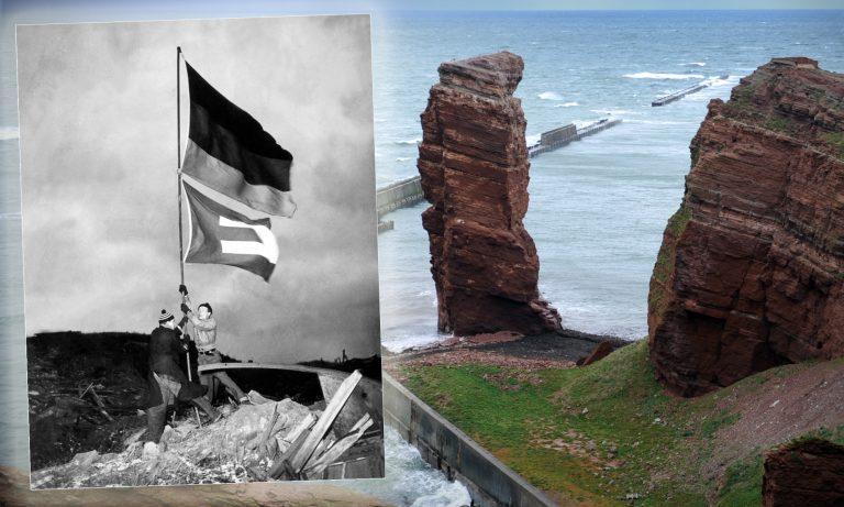 René Leudesdorff (l.) und Georg von Hatzfeld hissen am 20. Dezember 1950 die Deutschland- und Europaflagge